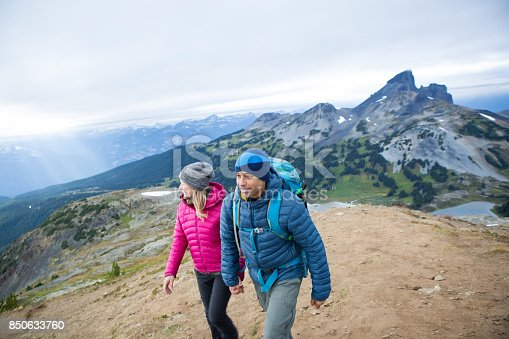 istock Young couple hike to the top of the mountain 850633760