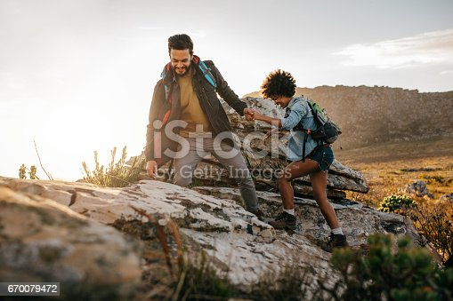 istock Young couple hiking in nature 670079472