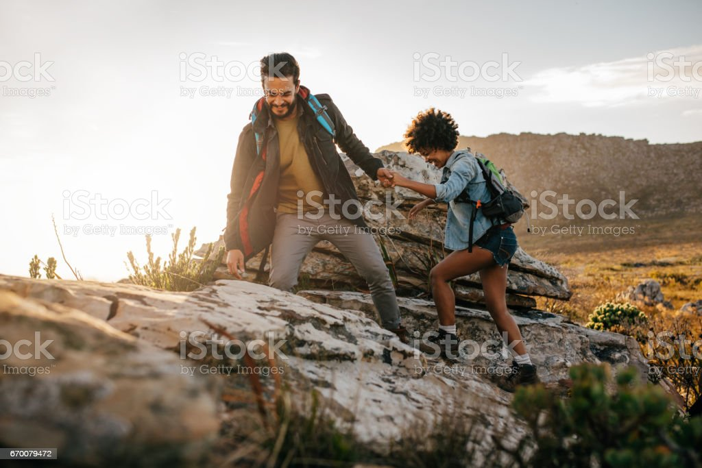 Young couple hiking in nature stock photo