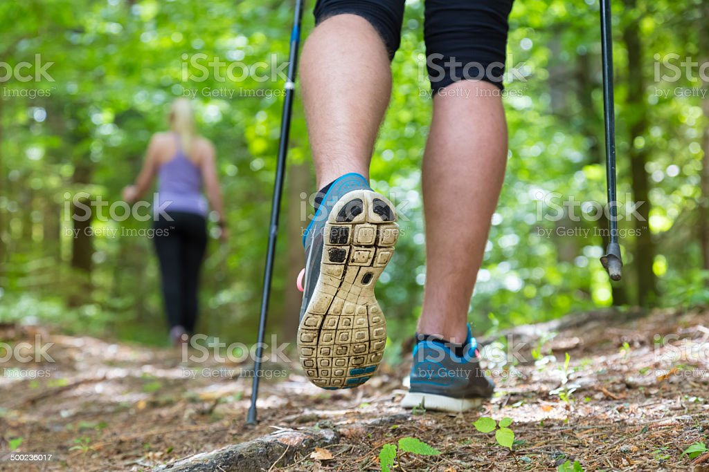 Young couple hiking in nature. Sport and exercise. stock photo