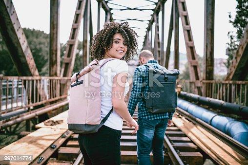 Young Couple Hiking On Railway Bridge