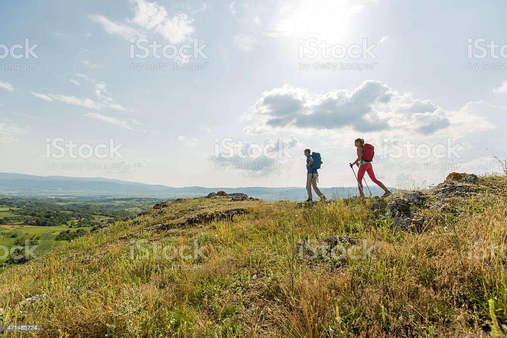 Young couple hiking on the mountain stock photo
