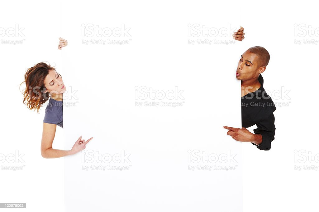 Young Couple Holding a Blank Sign - Isolated royalty-free stock photo