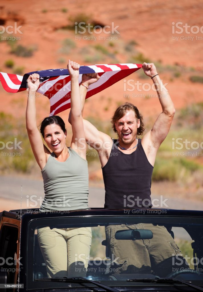 Young Couple Holding American Flag royalty-free stock photo