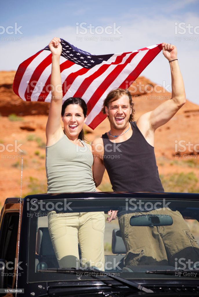 Young Couple Holding American Flag stock photo