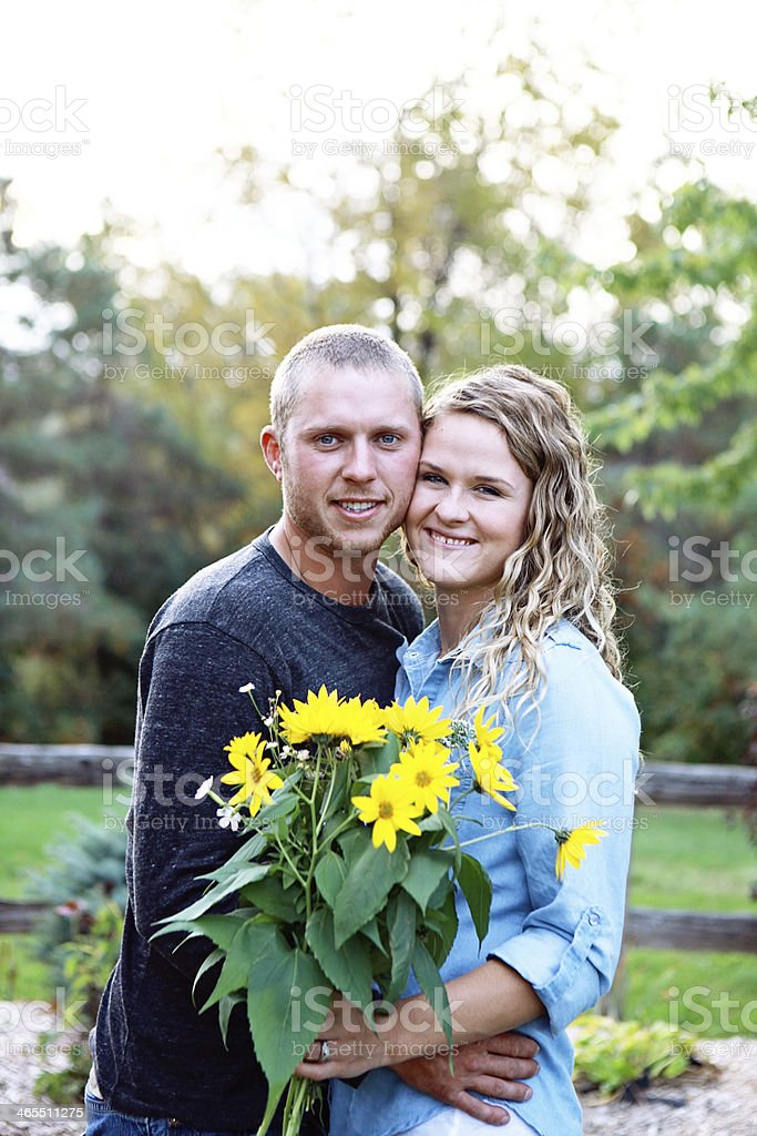 Young Couple Holding Bouquet of Flowers stock photo