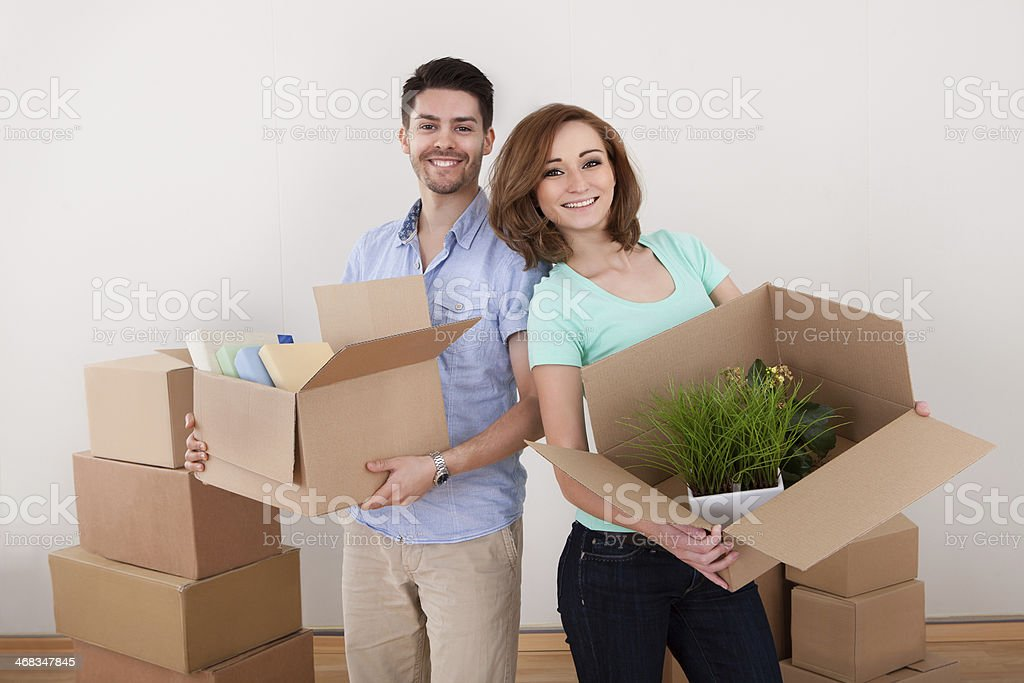 Young Couple Holding Cardbox royalty-free stock photo