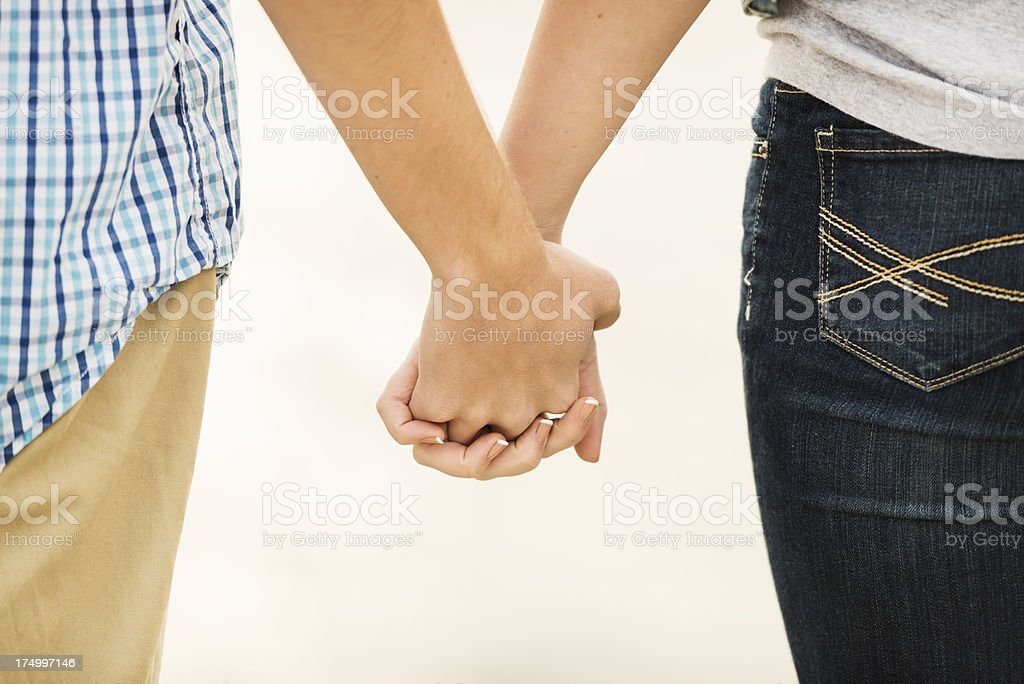Young Couple Holding Hands Horizontal royalty-free stock photo