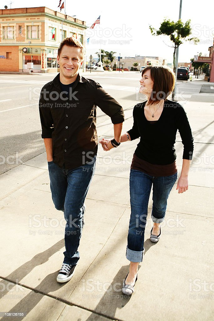 Young Couple Holding Hands in Downtown royalty-free stock photo