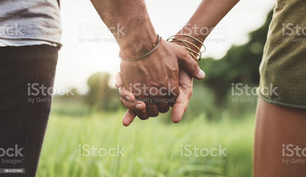 Young Couple Holding Hands In The Field Stock Photo & More