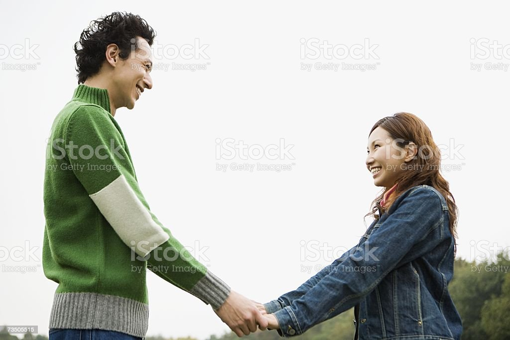 Young couple holding hands royalty-free stock photo