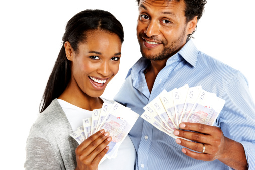 istock Young couple holding lots of money in hand smiling 175241867