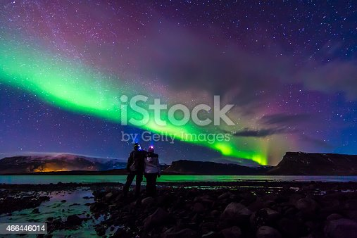 istock Young Couple hugged under Northern lights Aurora Borealis in Iceland 466446014