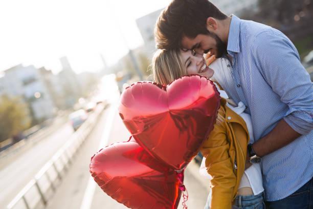 young couple hugging dating and kissing outdoor - kiss стоковые фото и изображения