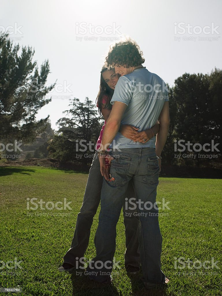 Young couple hugging in park royalty-free stock photo