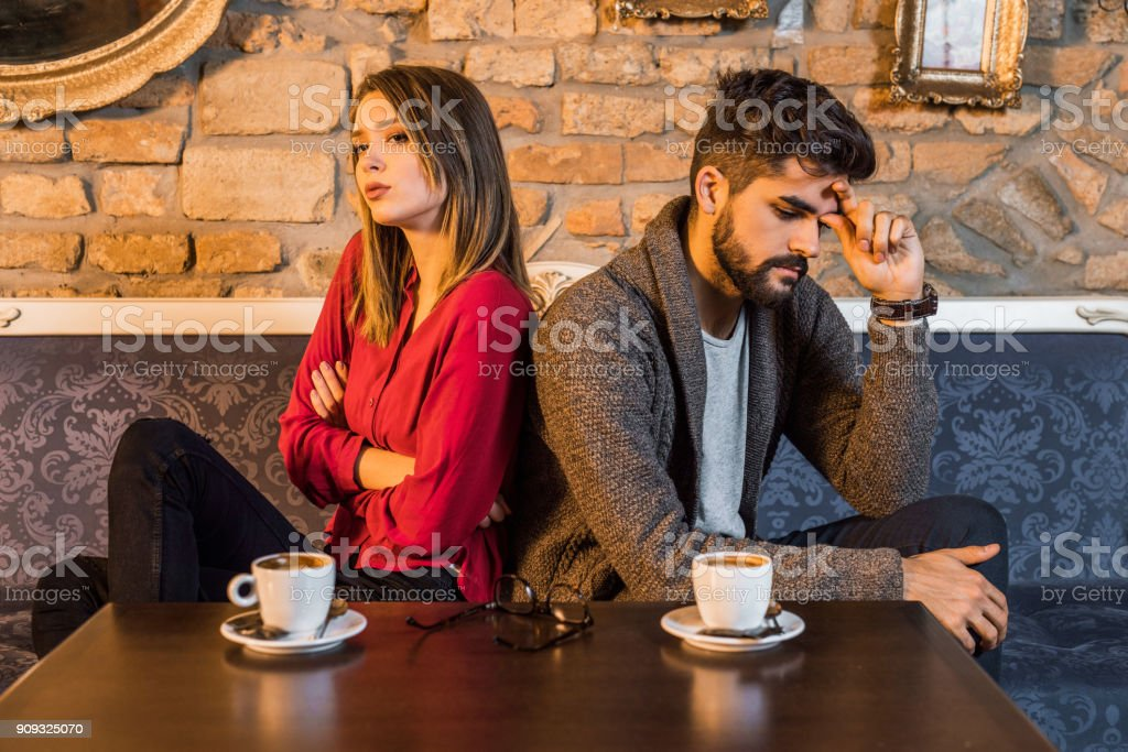 Young couple ignoring each other. stock photo