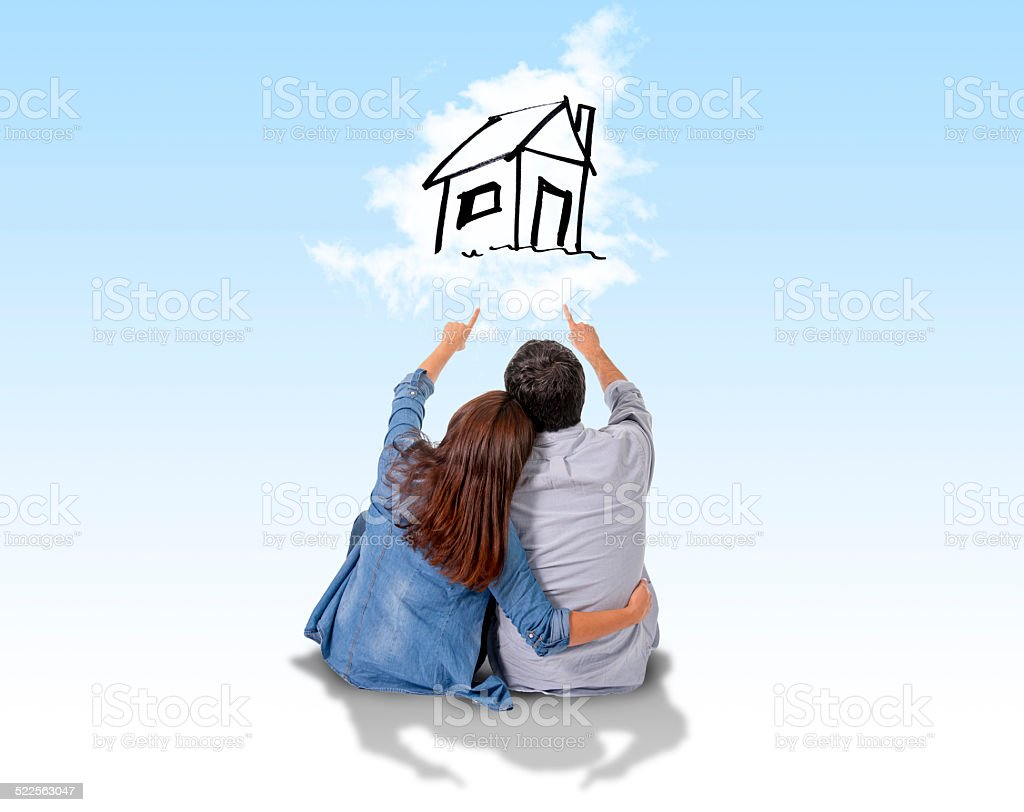 Young couple  imaging and dreaming of new house stock photo