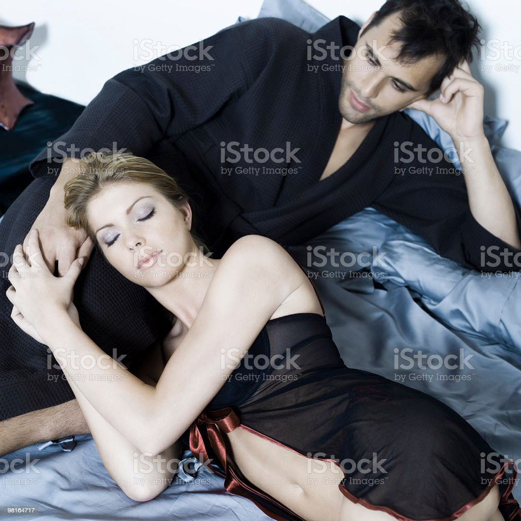young couple in a bed royalty-free stock photo