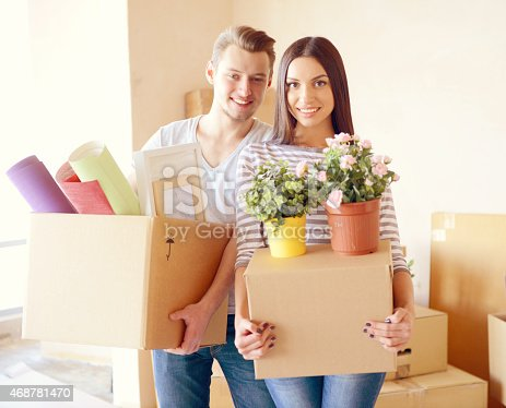 istock young couple in a new apartment with boxes for moving 468781470