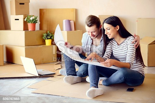 istock young couple in a new apartment with boxes for moving 539292665