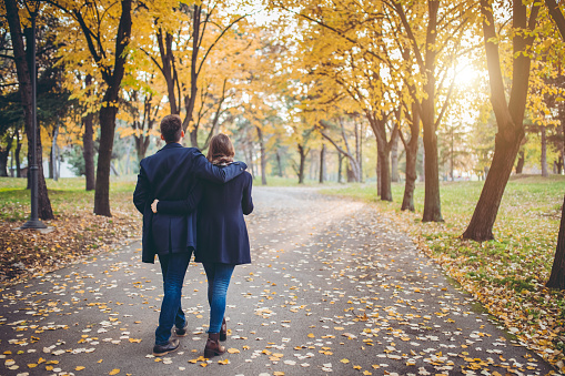 Young cute Caucasian couple in a public park.