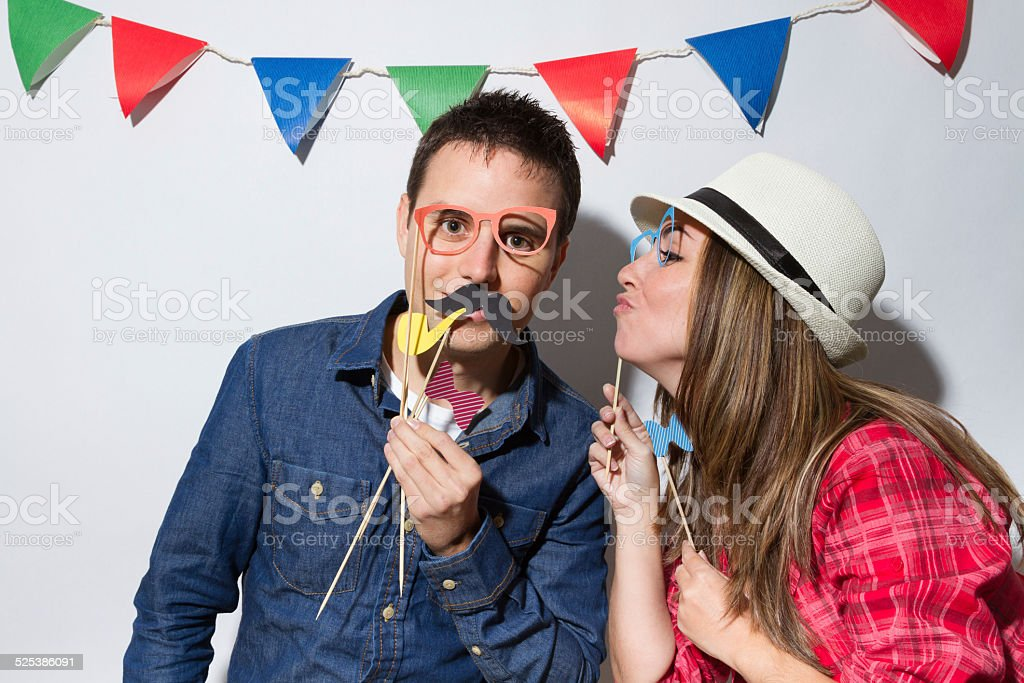 Young couple in a Photo Booth party stock photo