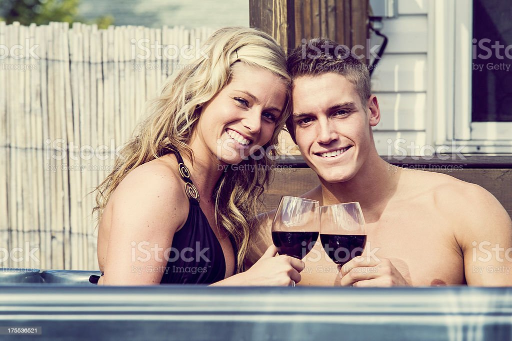 Young couple in a spa with glass of wine stock photo