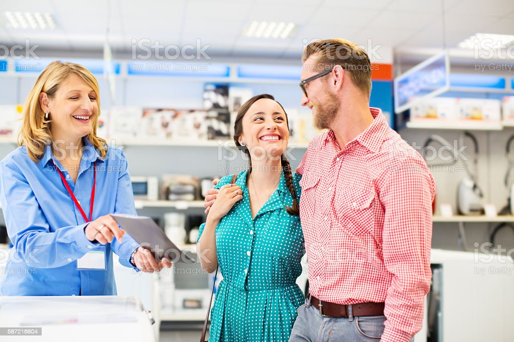 Young couple in an appliance store stock photo