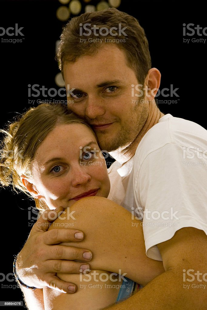 young couple in an embrace royalty-free stock photo
