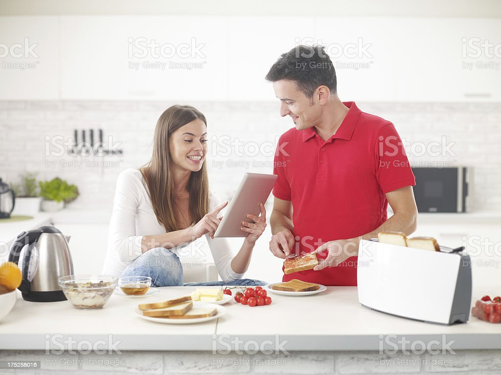 Young Couple In Bright Kitchen stock photo