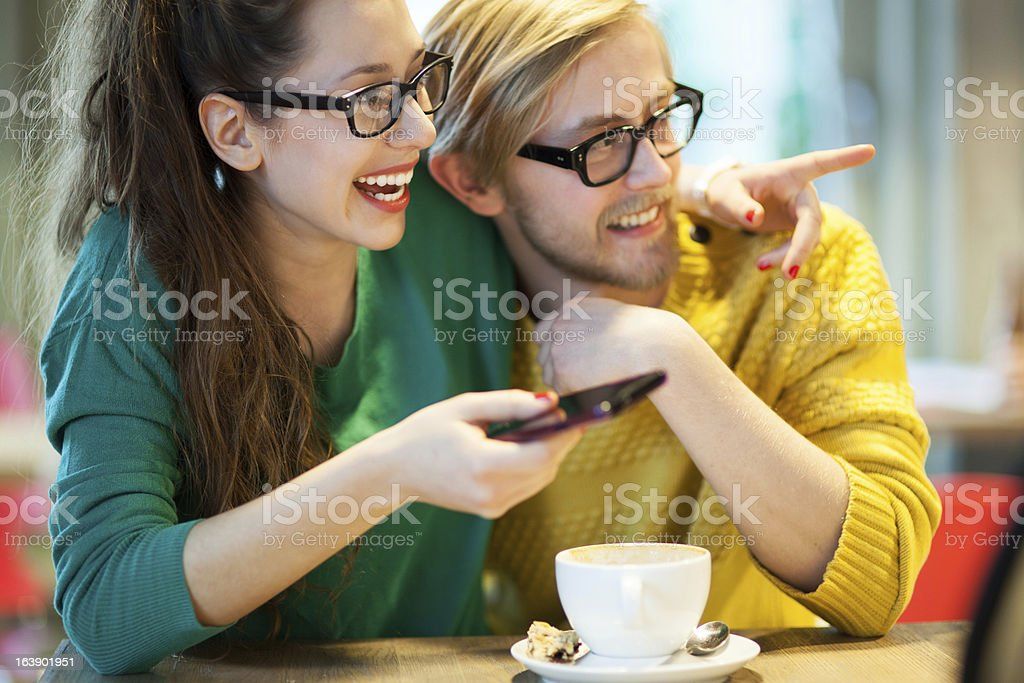 Young couple in cafe, laughing royalty-free stock photo