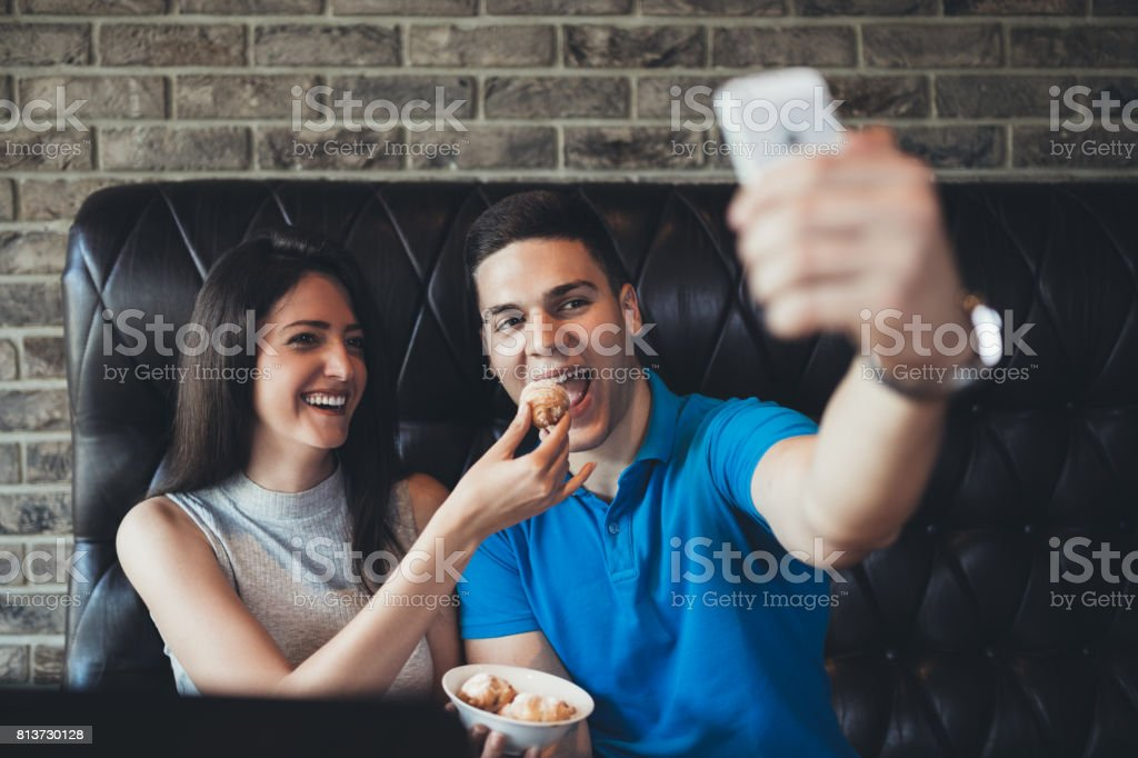 Young couple in cafe restaurant stock photo