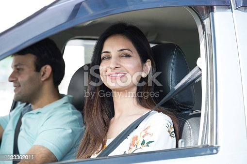 628541610istockphoto Young couple in car using pc tablet to navigate - Stock image 1133362011