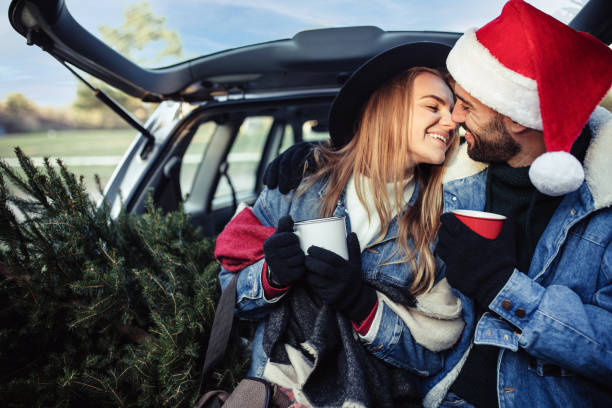 Young couple in Christmas shopping stock photo