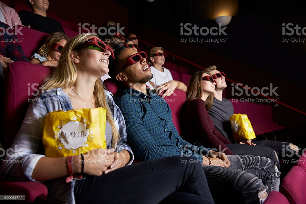 Young Couple In Cinema Wearing 3D Glasses Watching Film stock photo