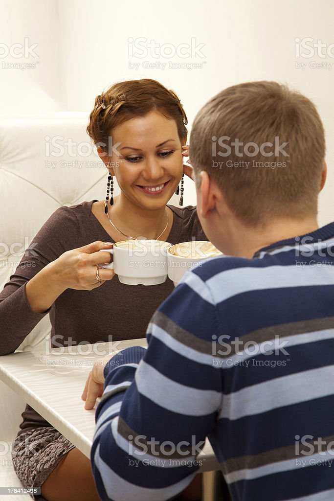 Young couple in coffee shop stock photo