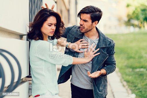 Annoyed boyfriend arguing with his girlfriend