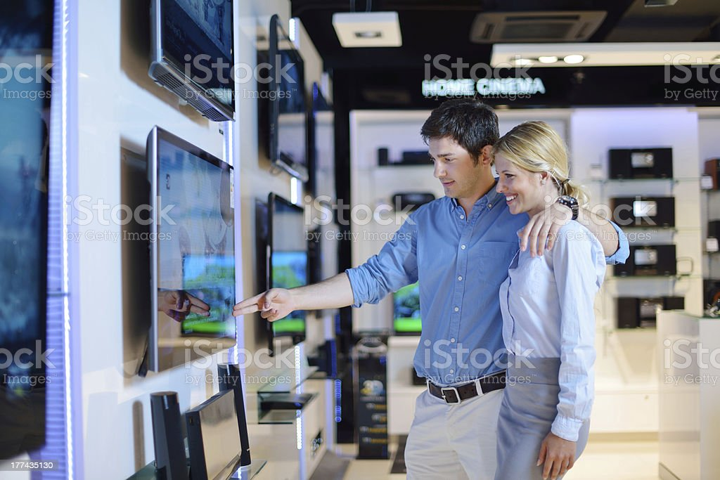 Young couple in consumer electronics store buy tv stock photo