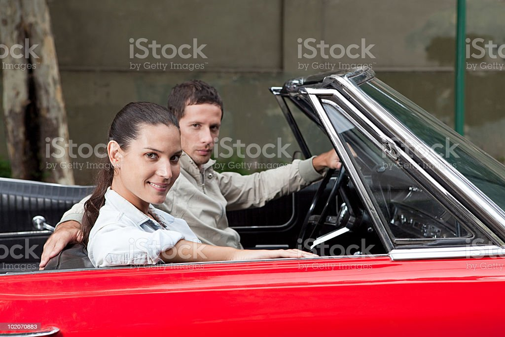 Young couple in convertible car royalty-free stock photo