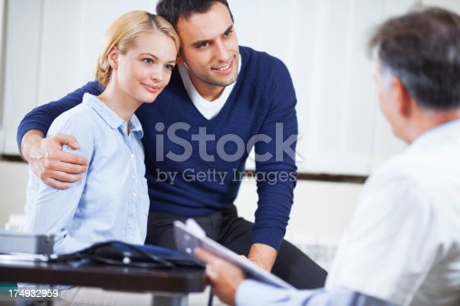479964946istockphoto Young couple in doctor office 174932959