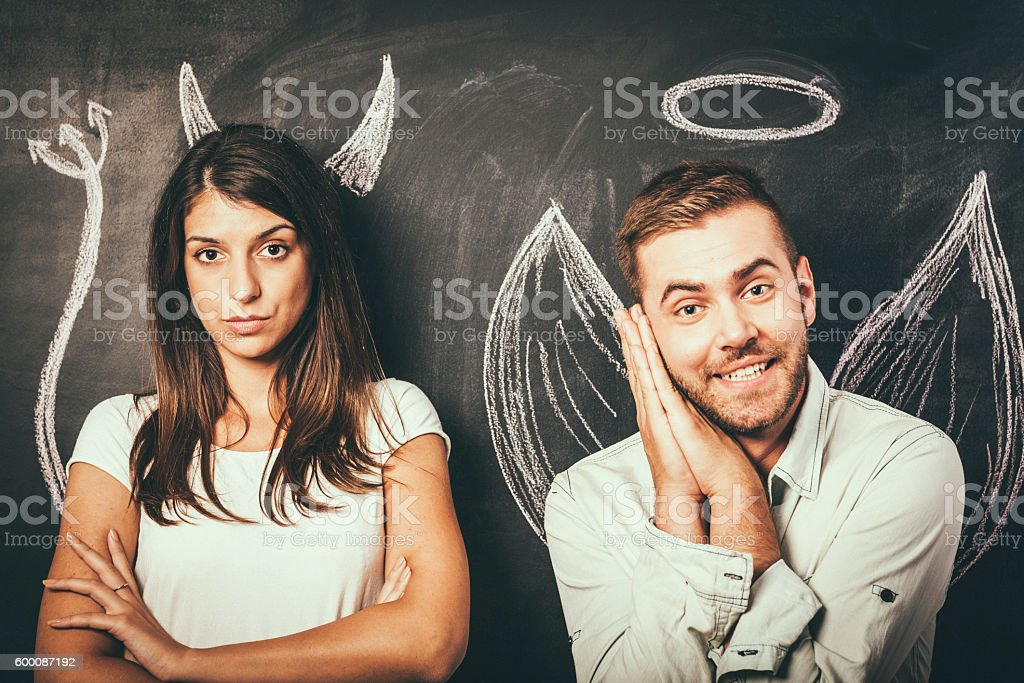 Young couple in front of a blackboard stock photo