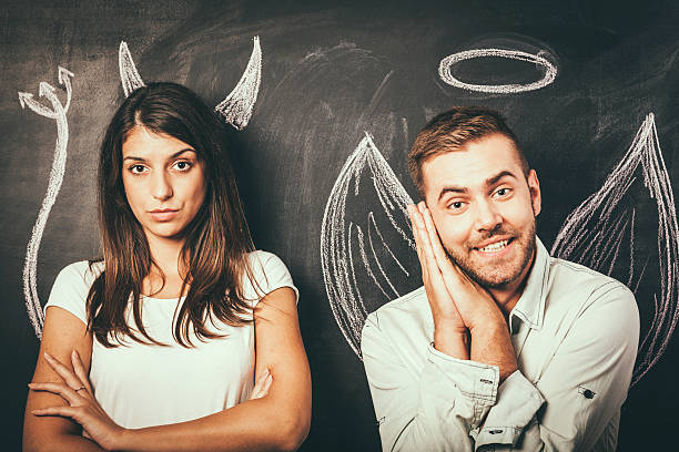 Young couple in front of a blackboard - Photo