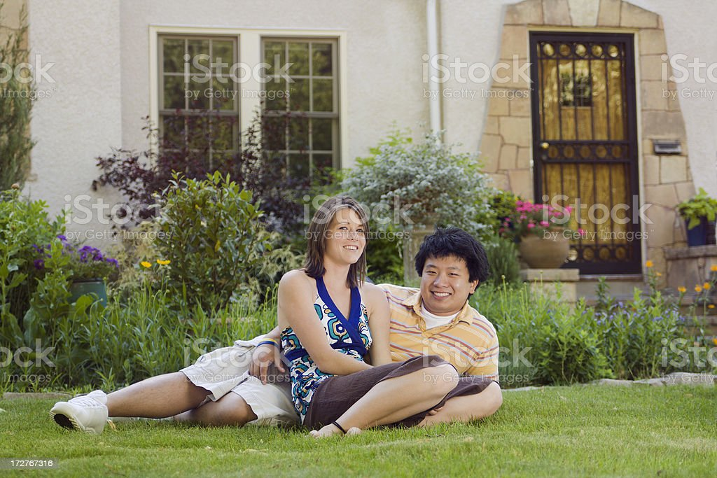 Young Couple in Front of a House royalty-free stock photo