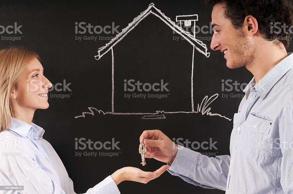 Young Couple in front of Sketched Home royalty-free stock photo