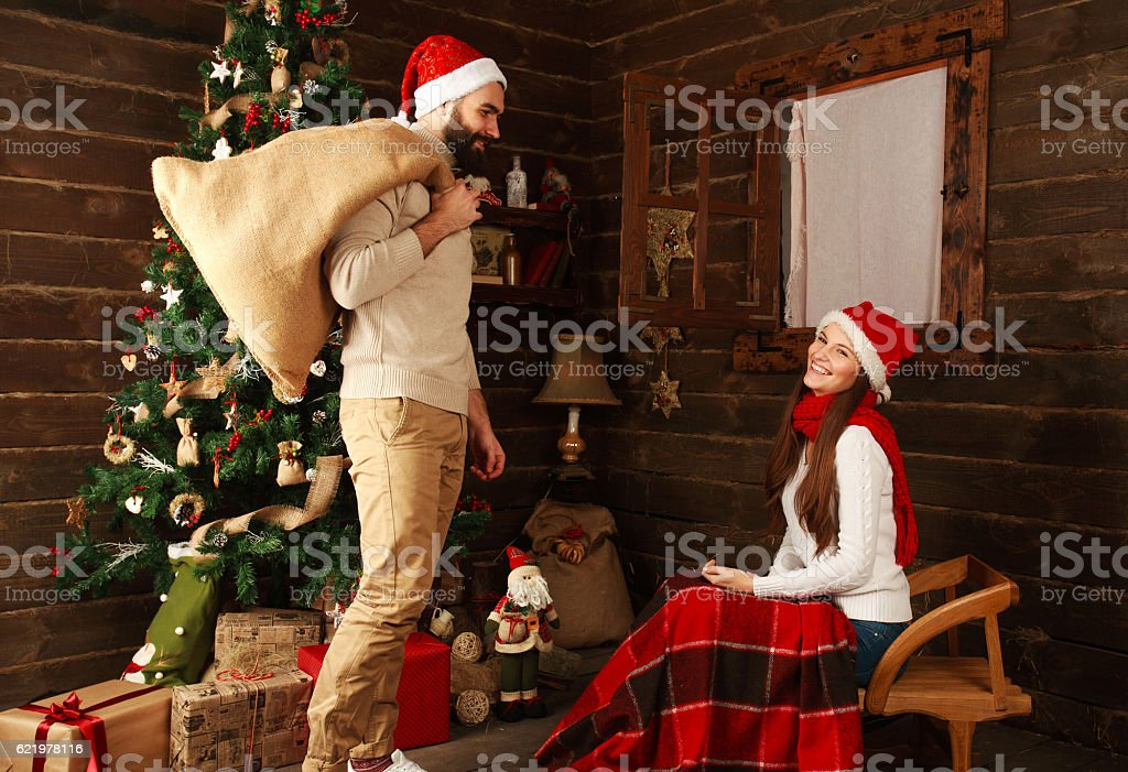 young couple in holiday home in christmas presents gifts royalty free stock photo
