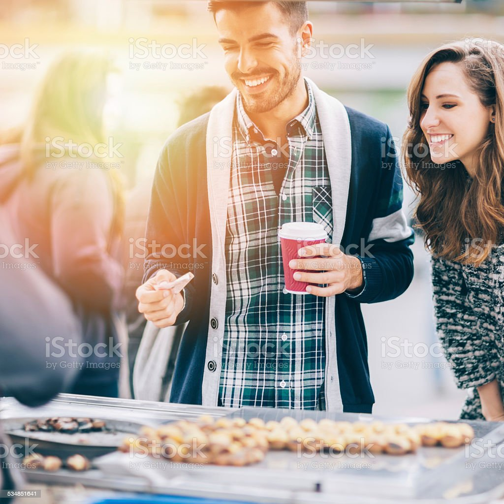 Young couple in Istanbul buying chestnuts stock photo