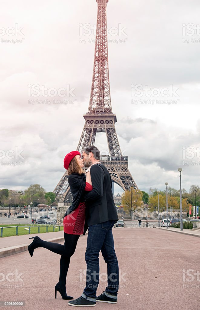 Young Couple In Love At Eiffel Tower Stock Photo & More ...