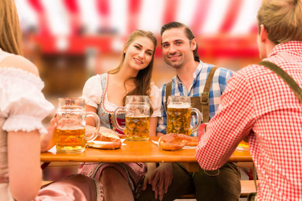 Young couple in love at Oktoberfest beer tent – Foto