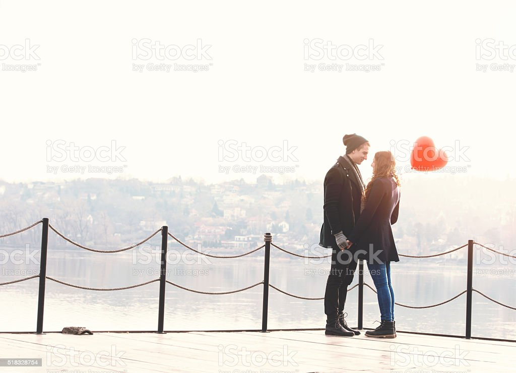 Young couple in love at the riverside bildbanksfoto