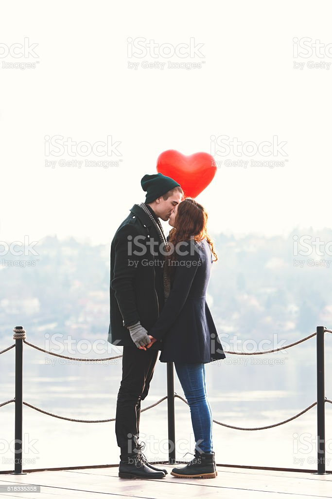Young couple in love at the riverside stock photo